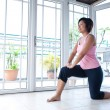 Asian woman doing stretching exercise — Stock Photo #7111916