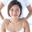 Asian woman receiving a shoulder massage — Stock Photo #7111958