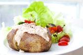 Jacket potato with tuna and fresh salad — Stock Photo