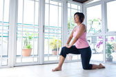 Asian woman doing stretching exercise — Foto de Stock
