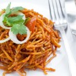 Delicious stir fried noodles Asian style - Stock Photo