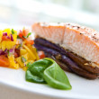 Baked salmon on bed of grill aubergine with serving of salsa — Stock Photo #7131857