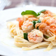 Prawn and smoke salmon fettucine with spinach — Stock Photo