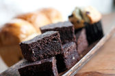 Chocolate brownies, muffin and loaf of sweet bread — Stock Photo