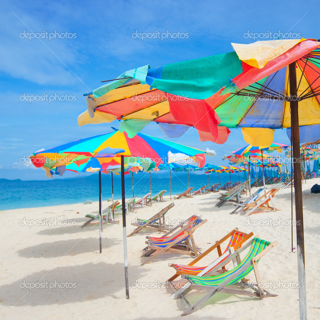 Colorful Sun Parasols And Sundeck Chairs On Beautiful
