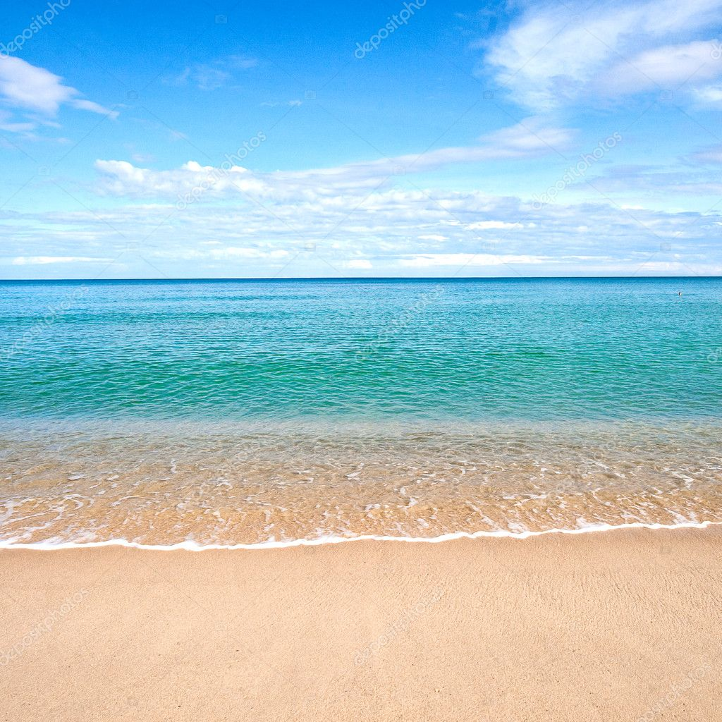 Sandy Beach: Beautiful Sandy Beach With Calm Water Against Blue Skies