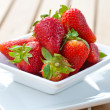 Stock Photo: Delicious fresh ripened strawberries in white bowl.
