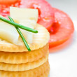 Crackers and cheese with sliced tomatoes — Stock Photo