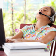 Girl listening to headphone while on laptop computer, — Stock Photo