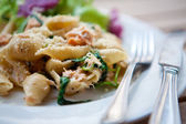 Delicious pasta with salmon and spinach. — Stock Photo