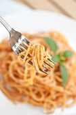Spaghetti with tomato sauce and basil — Stock Photo