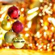 Royalty-Free Stock Photo: Gold Christmas decoration on red bokeh background