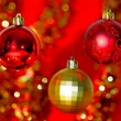 Stock Photo: Gold Christmas decoration on red bokeh background