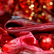 Gold Christmas decoration on red bokeh background - Stock Photo