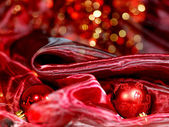 Gold Christmas decoration on red bokeh background — Stock Photo