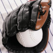 Glove and softball - Stock Photo