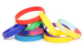 Various charity fundraising wristbands — Stock Photo