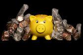 Yellow piggybank with sterling money — Photo