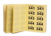 Yellow raffle ticket book — Stock Photo