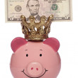King Piggybank with five dollars — Stock Photo #7156712