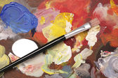 Artist palette with paint brush background — Stock Photo