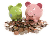 Piggy bank moneybox with British currency coins — Stock Photo
