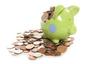 Smashed piggy bank moneybox with British currency coins — Stockfoto