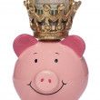 King Piggybank with US dollars - Foto Stock