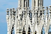 Detail of the spires of the duomo of Milan with statue — Stock Photo
