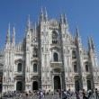 White facade in front of the cathedral of Milan with high peaks — Stock Photo