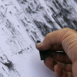 Stockfoto: Hand of road artist that it designs with coal