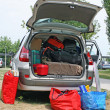 Stock Photo: Family car with suitcases and bags to return from vacation
