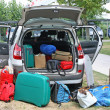 Stock Photo: Family car full of luggage ready for holidays
