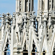 Detail of the spires of the duomo of Milan with statue — Foto Stock
