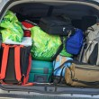 Very car with the trunk full of luggage ready for the departure of family h — Stock Photo #7125951