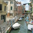 Venetian canal boat and clothes hanging in the sun — Stock Photo