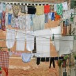 Street in venice with washing hung out to dry in the sun over the water cha — Stock Photo