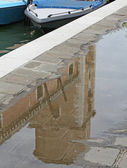 Reflection of a tower in Venice in a puddle left from the high water — Stock Photo