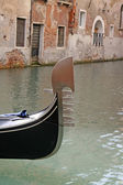 Top of the gondola in a water canal in venice — Stock Photo