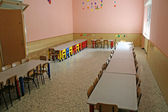 Refectory tables with chairs and a kindergarten — Stock Photo