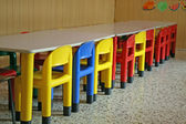 Colored row of empty chairs in a dining room of a kindergarten — Stock Photo