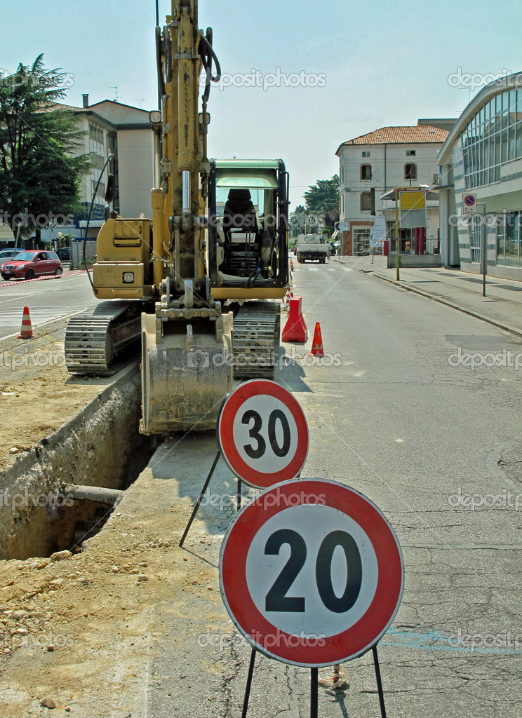 Bulldozer and signs during an excavation work on a city street — Stock Photo #7126024
