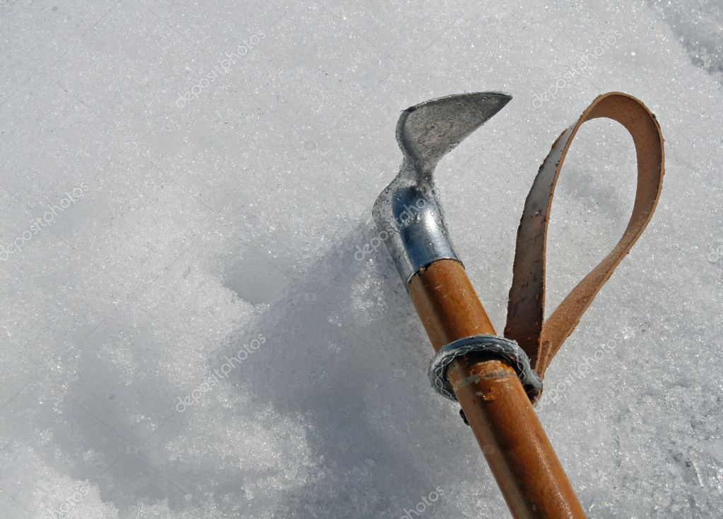 Ax hook firmly fixed in a wall of ice in high mountains — Stock Photo #7128683