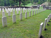 Headstones with crosses in a row — 图库照片