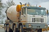 Mixer for the transportation of cement and concrete on a construction site — Stock Photo