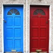 Two doors with bright colors at the entrance to a house in Northern Europe — Stock Photo