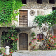 Stock Photo: Old house in courtyard of mountain village
