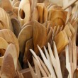 Foto Stock: Wooden spoons carved by skilled craftsmon sale
