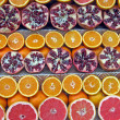 Colorful lemons, oranges, grapefruits and pomegranates for sale — Stok fotoğraf