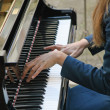 Stock Photo: Delicate hands gently playing melody on piano